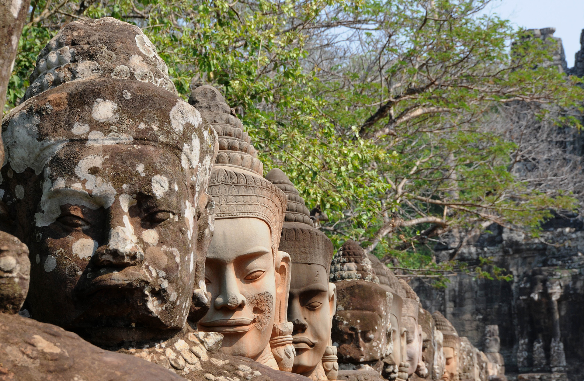 Statues lining the bridge outside the south gate of Angkor Thom, Cambodia