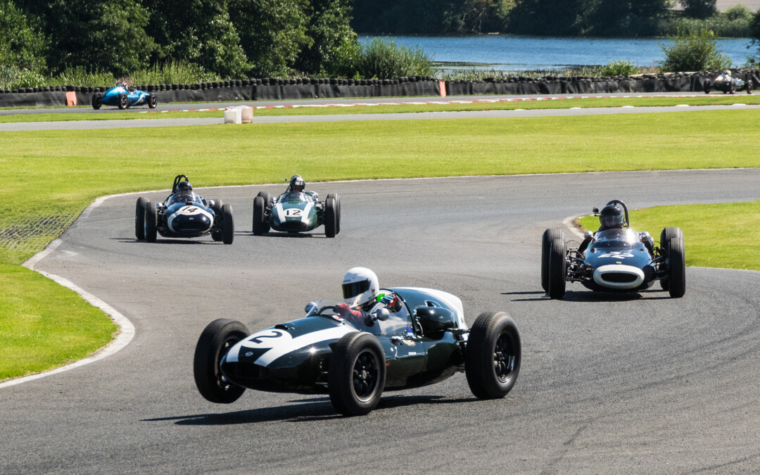 Rod Jolley in a 1958 Cooper fighting to hold off Peter Horsman's 1961 Lotus in the Oulton Park Gold Cup