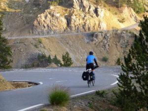 Tom Bruce cycling through the Casse Deserte on the Col de Izoard, Route des Grades Alpes