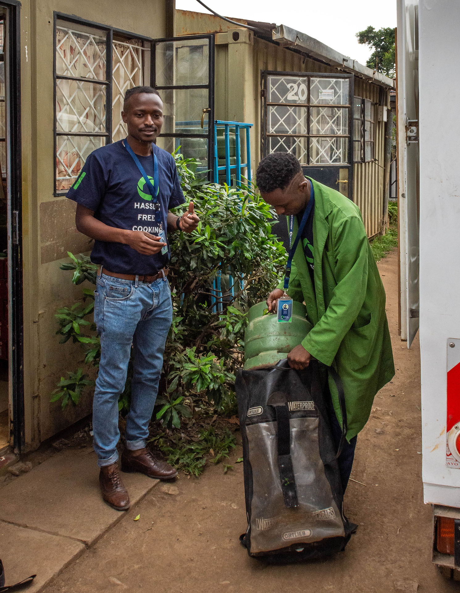 Paygo staff preparing to deliver a LPG cylinder refill as part of the service of a 'pay as you go' system, Nairobi, Kenya
