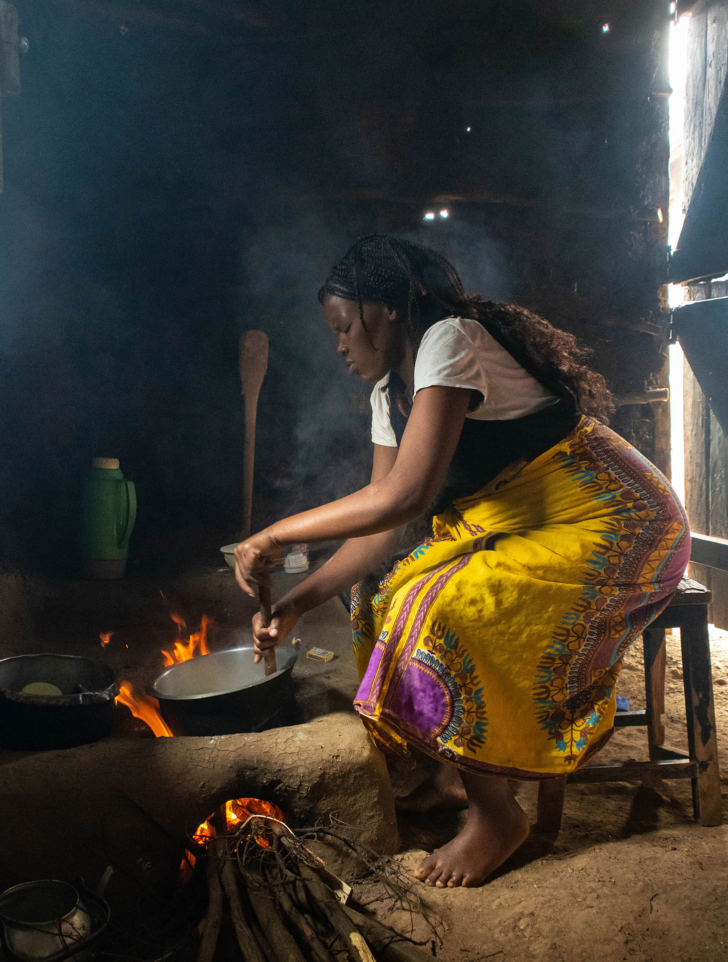 Cooking the staple Ugali over a wood fire in a heavily smoke polluted kitchen in rural Kenya