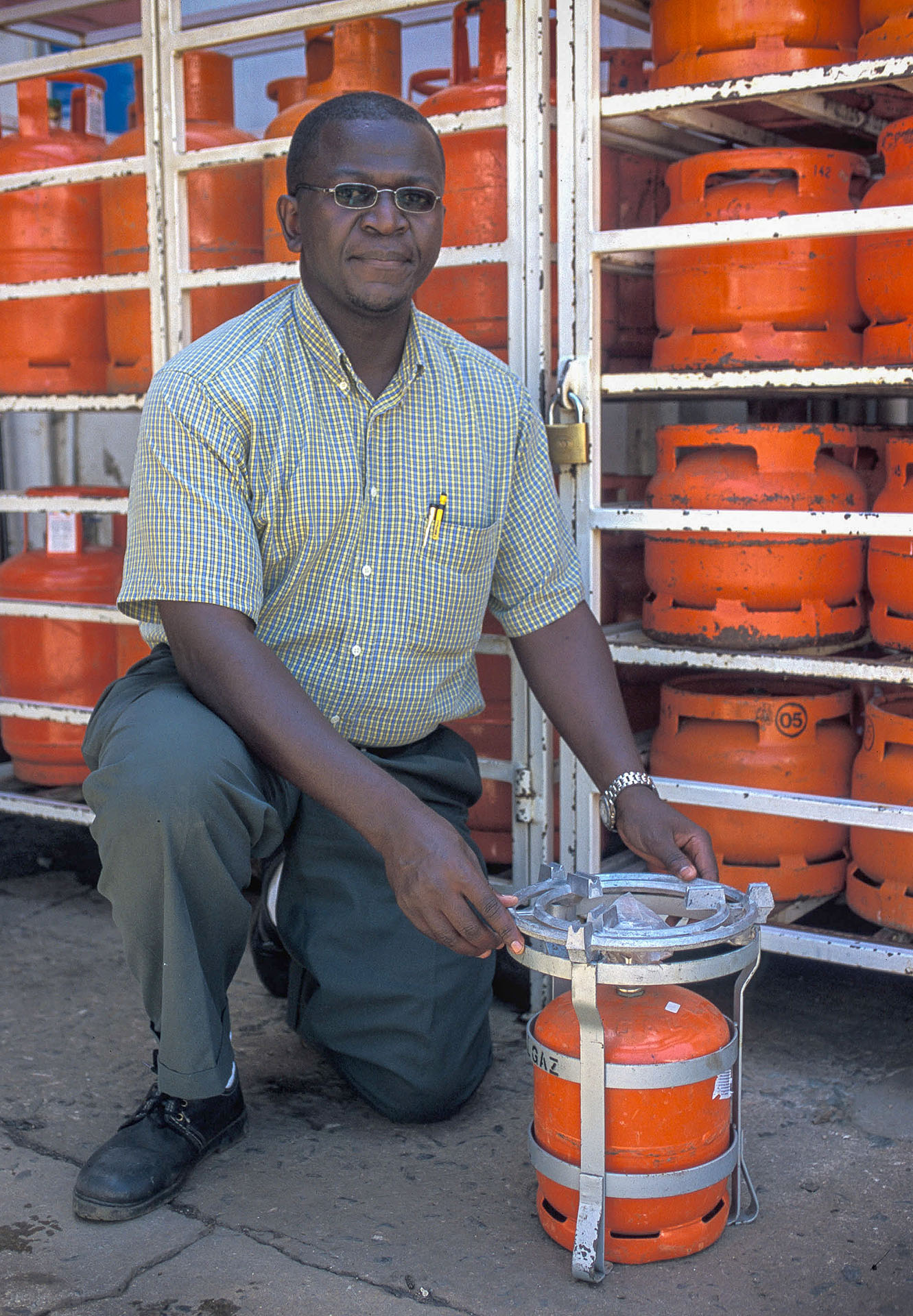 Store of LPG cylinders with 'Meko' type single-burner stoves attached, Kenya