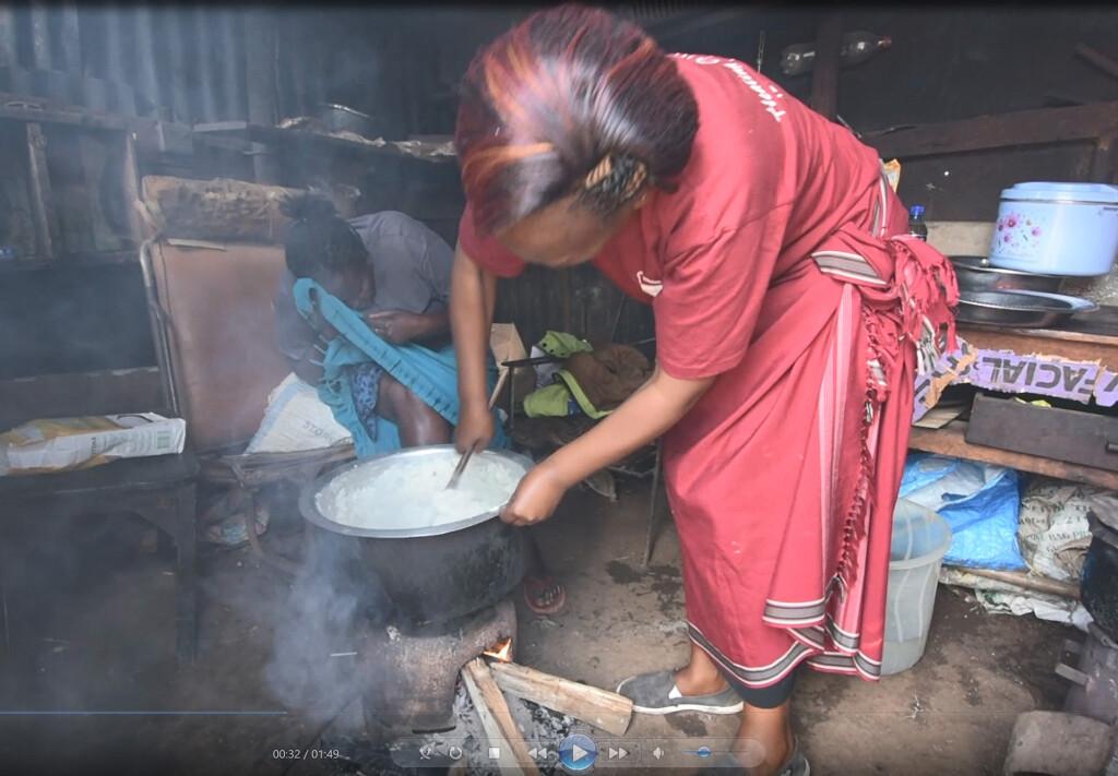 Women cooking Ugali on wood stove in Kenya