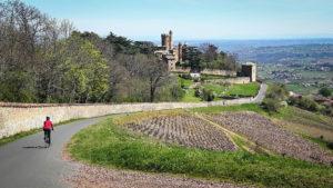 Cycling past the Beaujolais vineyards beside the Château de Montmelas-St-Sorlin